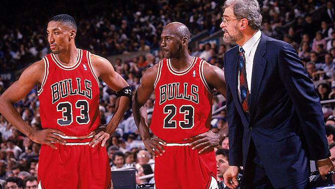 Image of Coach Phil Jackson with Michael Jordan and Scottie Pippen in their glory days.