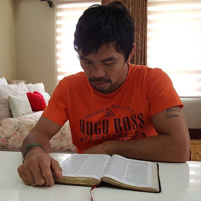 Manny Pacquiao studying the Bible.