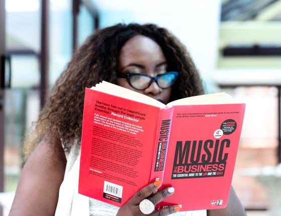 Mercy B reading Music - The Business by Ann Harrison