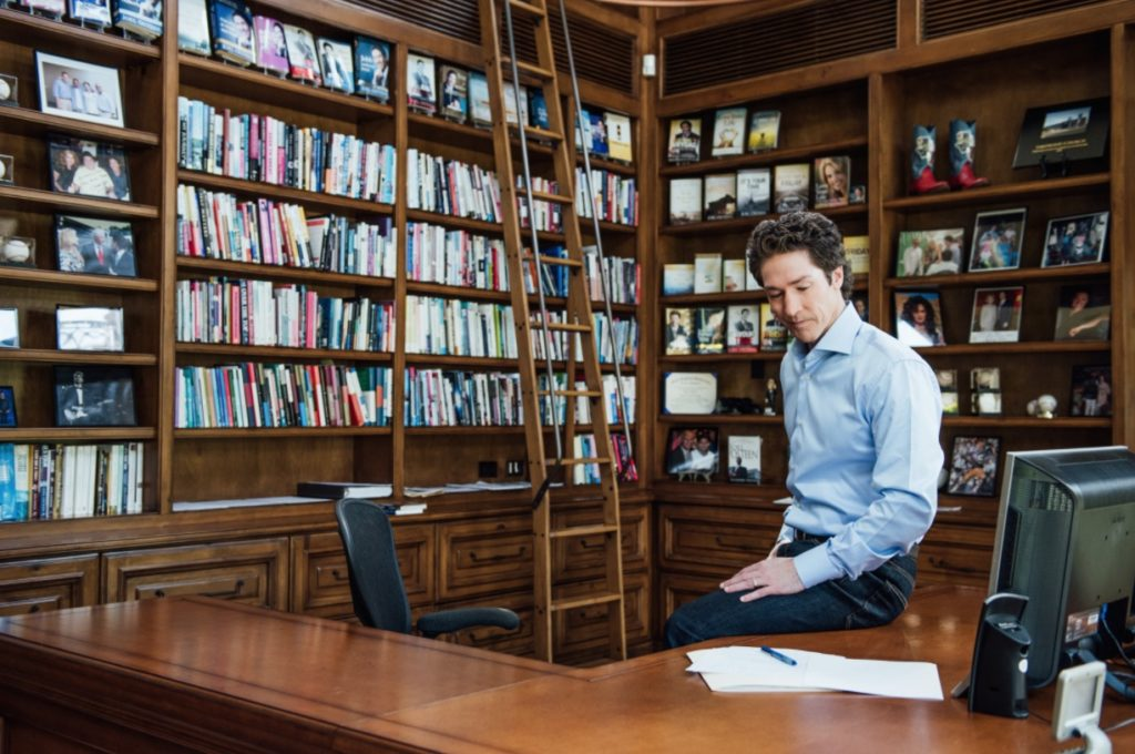 Joel Osteen working in the office
